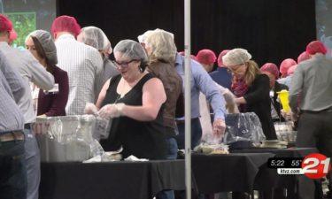 Hayden Homes pack meals for needy